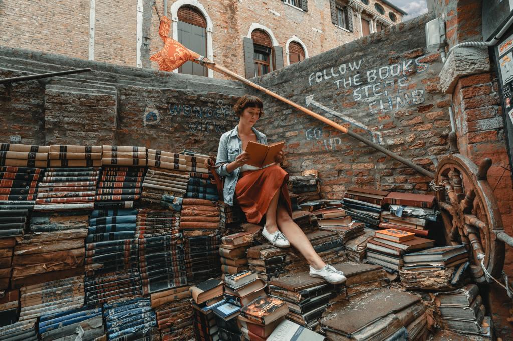 woman sitting on books -- fancy comma blog
