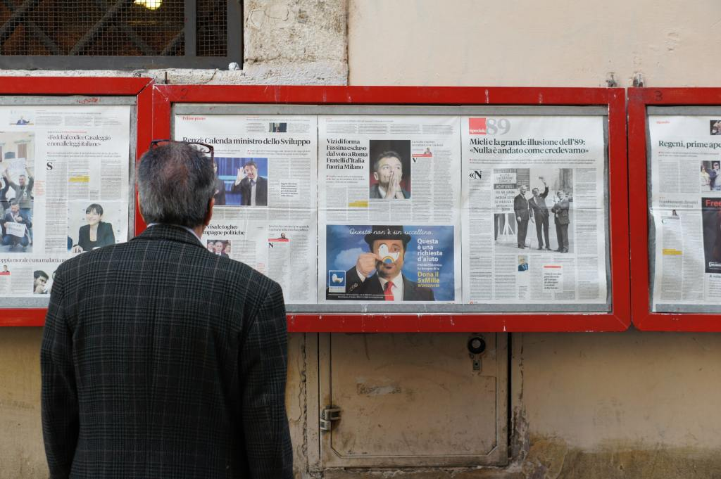 man reading news headlines