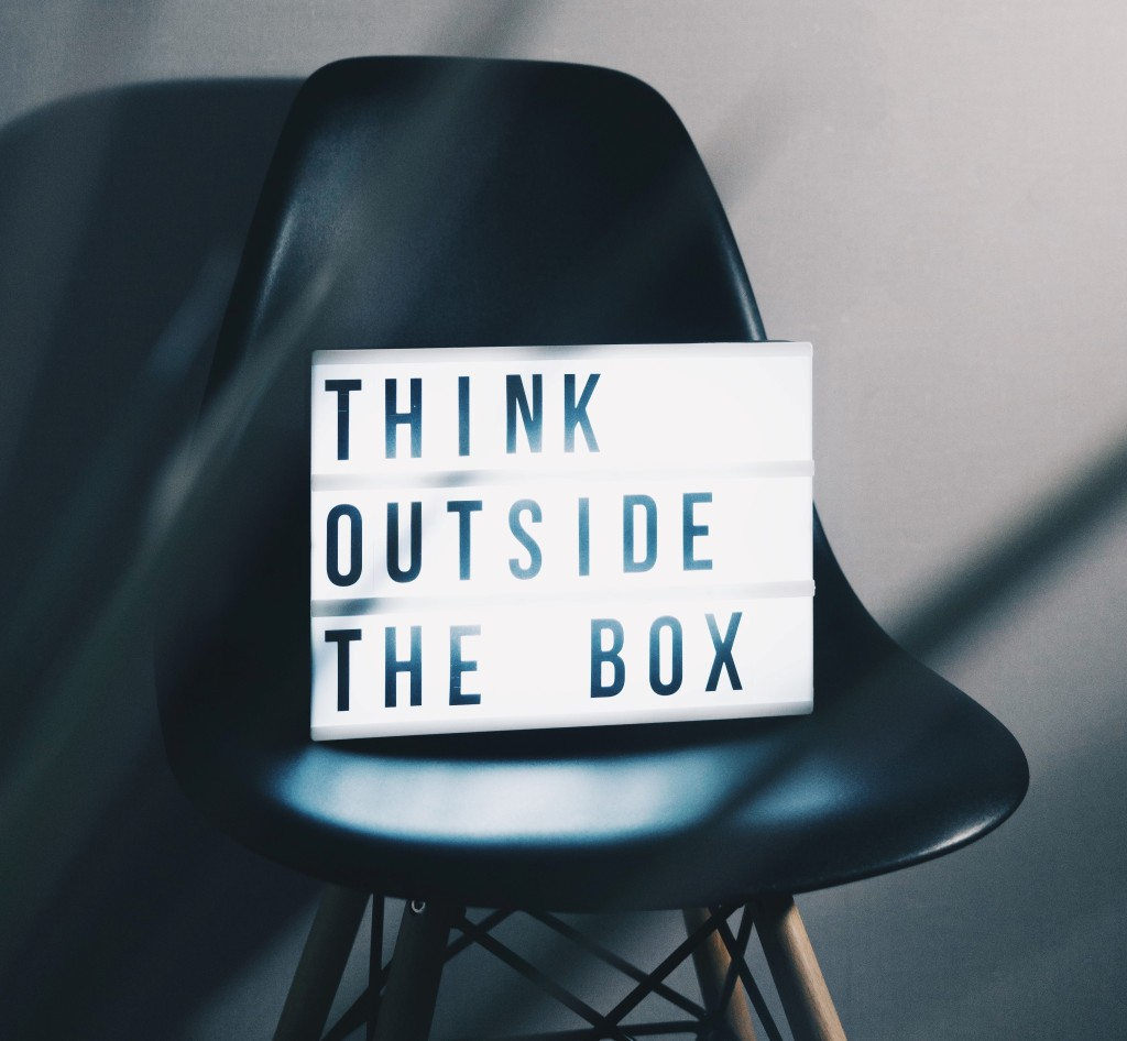 """think outside the box"" sign"