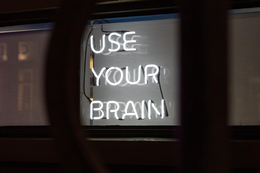 neon sign that says 'use your brain'
