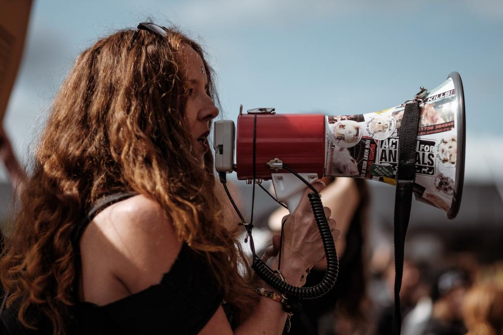 london woman talking into megaphone