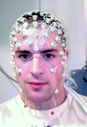 photo of a research study participant undergoing electroencephalography or EEG