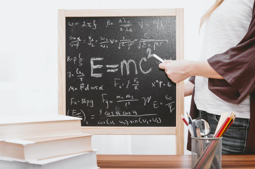 photo of chalkboard with albert einstein's e=mc^2 equation