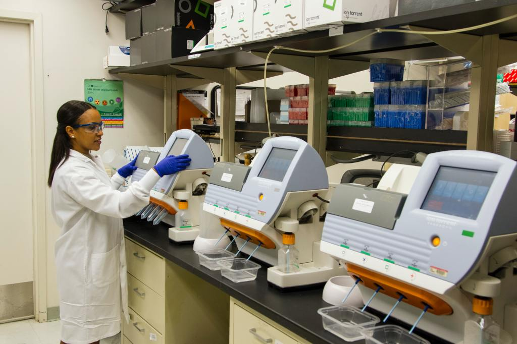 photo of a laboratory scientist working with lab equipment