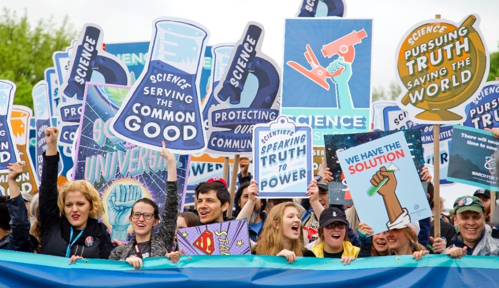 photo of people holding signs at a march for science rally