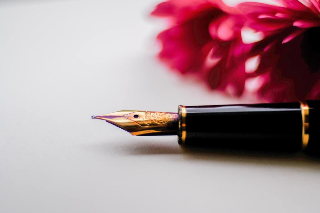 photo of a pen with flowers in the background