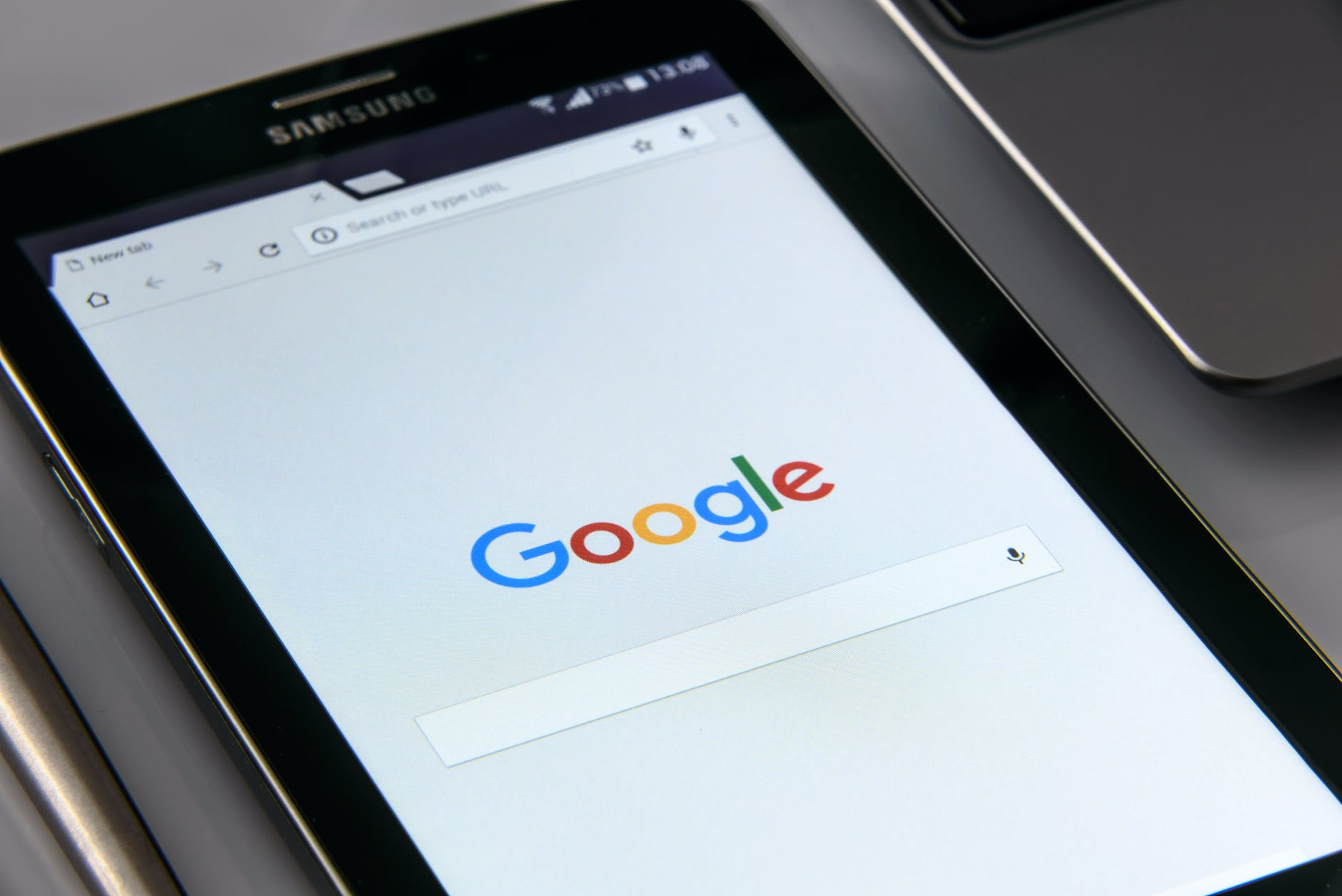 photo of a smartphone with a google search engine tab open