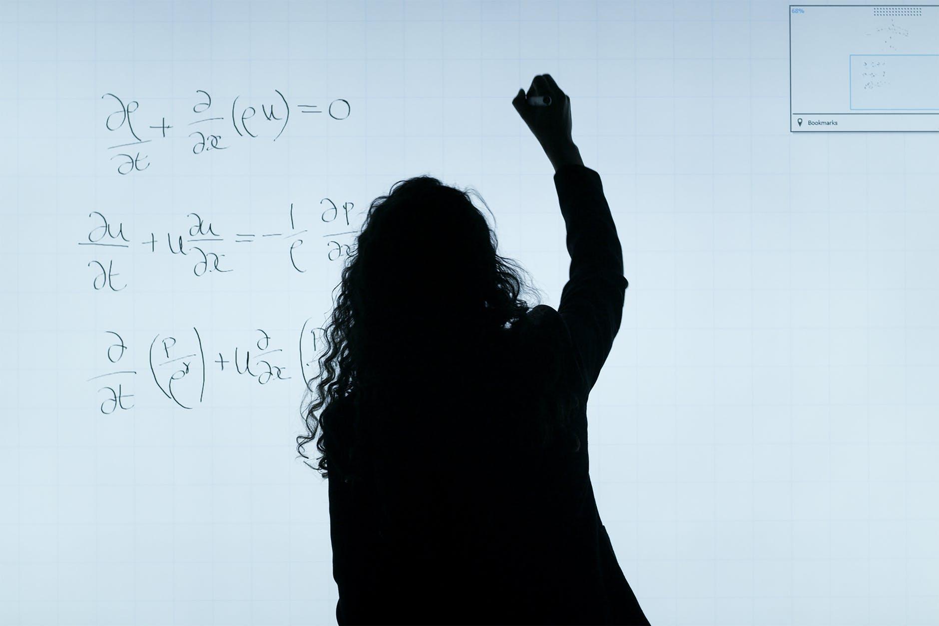 woman writing equations
