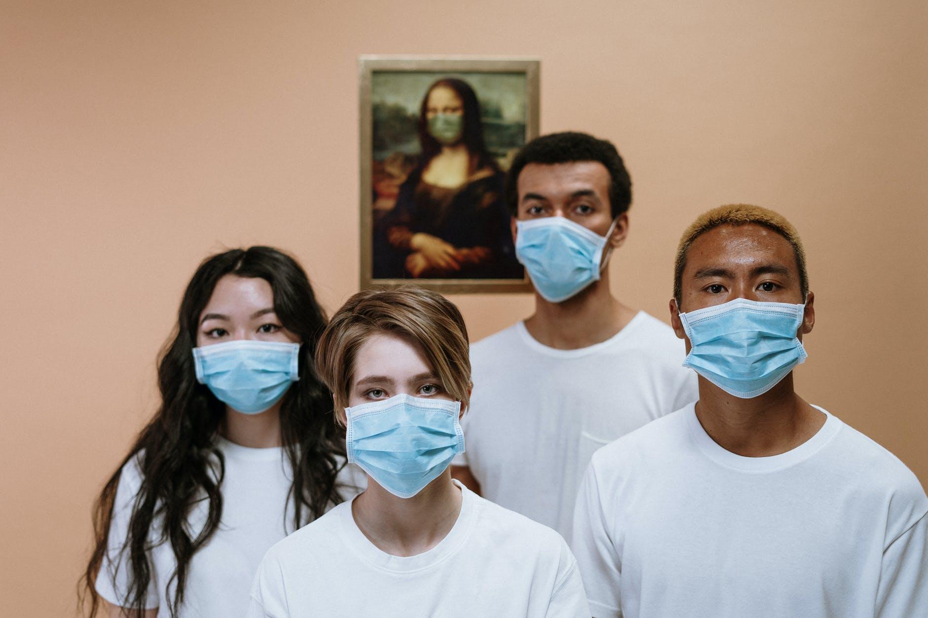photo of people wearing masks