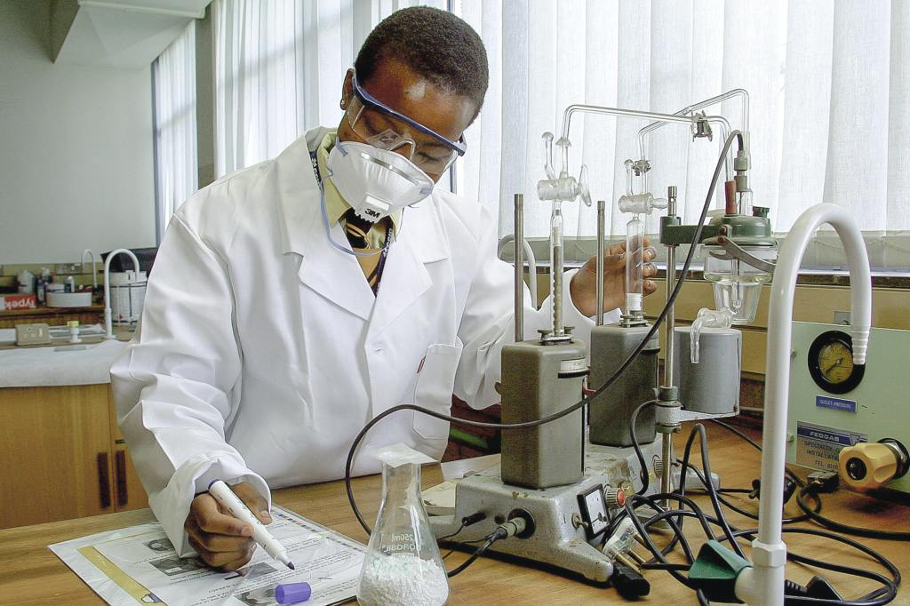 photo of man doing science in a laboratory