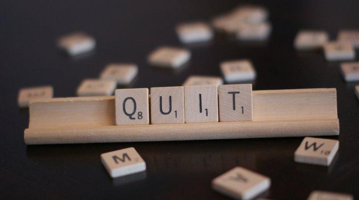 "photo of scrabble letters that read, ""quit"""