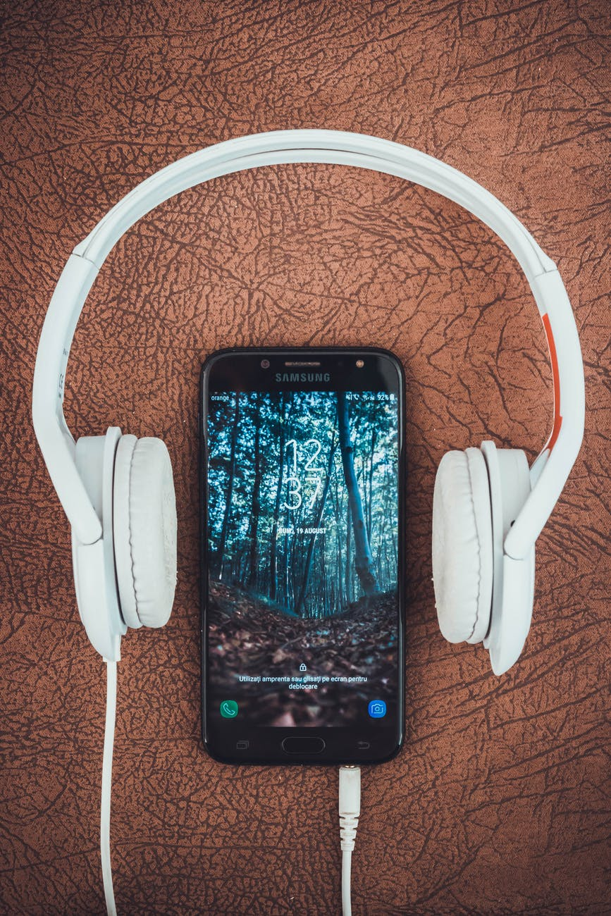 photo of a cell phone and headphones